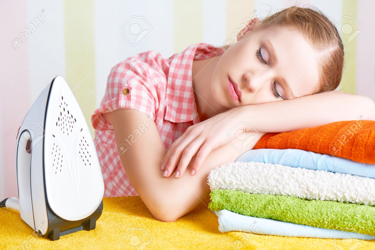 /pic/uploaded/39079846-tired-housewife-fell-asleep-on-the-ironing-board-with-iron-Stock-Photo.jpg